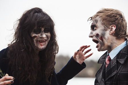 toothless: Toothless zombie woman and her frightened boyfriend Stock Photo