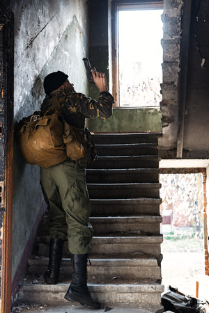millitary: Peofessional combatant captured in the ruined house