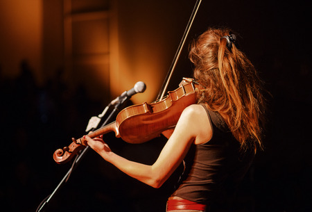 The violin player performing in the hall