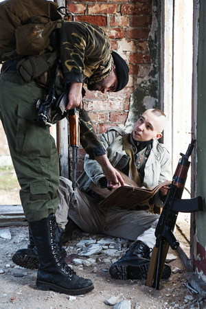 millitary: Two military males discussing the capture plan