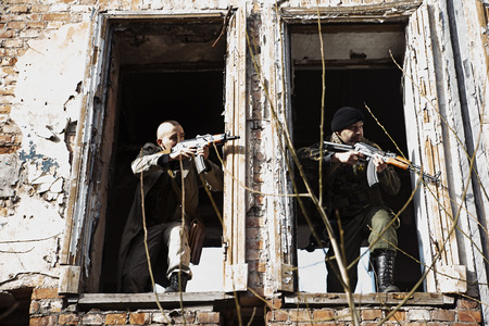 millitary: Combats shooting out of the ruined windows