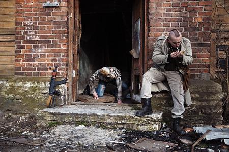 hitman: A zombie ready to attack the hitman Stock Photo