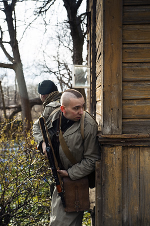 millitary: The skinhead looks out of the corner