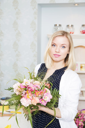 Lady holding gifted flowers in her hands