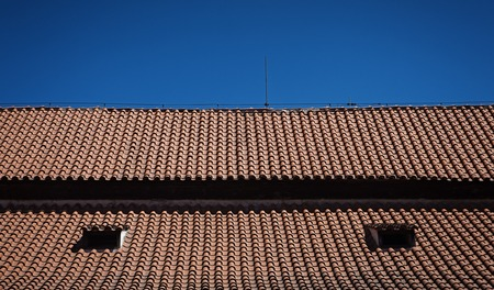 necessity: Straight symmetrical lines of red tiled roof