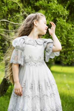 wind blown hair: Beautiful long princess hair blown by wind Stock Photo