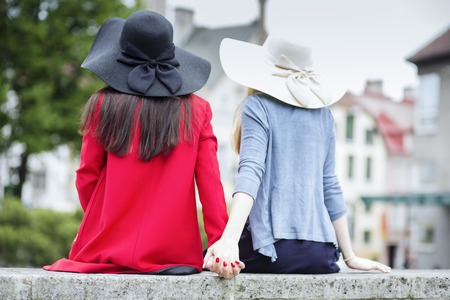 feel affection: Couple of female friends holds their hands