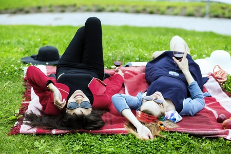 feel affection: Young women on the red picnic blanket