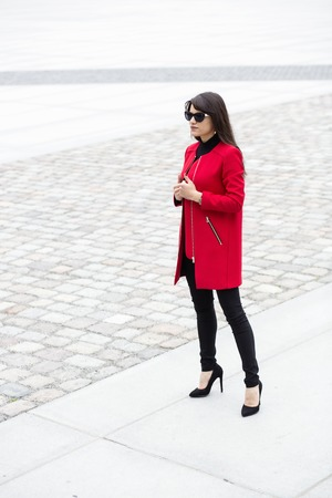 dependent: Self dependent female in a red coat