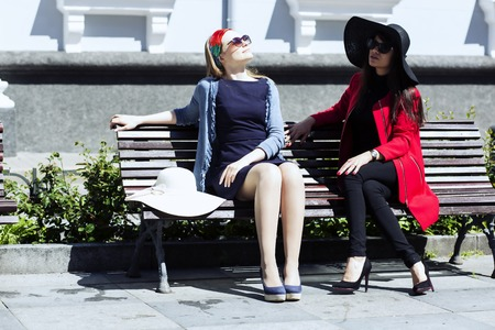feel affection: Couple of young female friends enjoying sun Stock Photo
