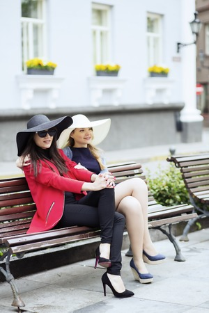 feel affection: Two young females in different color hats