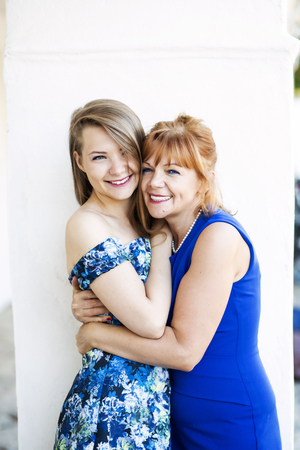 sweetly: Cheerful mother and daughter holding together sweetly Stock Photo