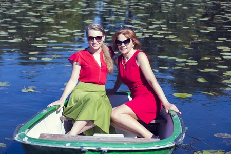 women friendship: Female friends sailing in the small boat
