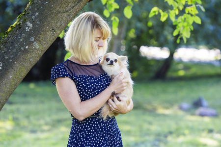 tenderly: Woman looking tenderly at her sweet baby-dog Stock Photo