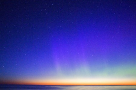 protons: Aurora Borealis reaching the deep blue sky