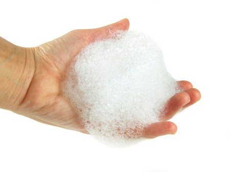soapsuds: hand palm  with soapsuds on white background
