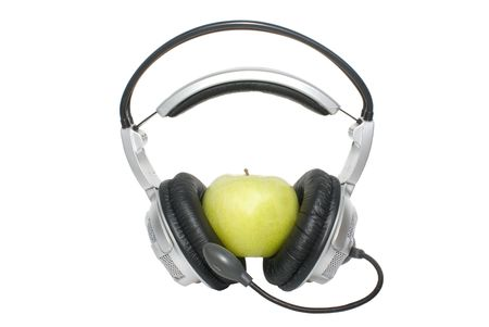 apple in earphone ������������ on white background photo