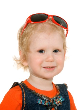 small girl is with spectacles to dress on head photo