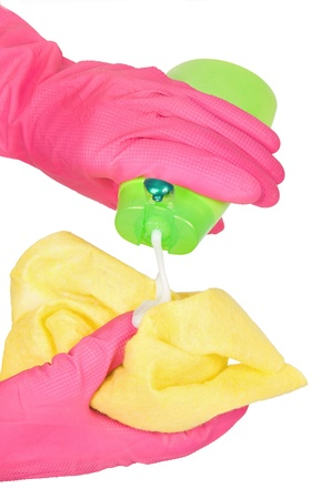 hands in rubber gloves with a rag and bottle green photo