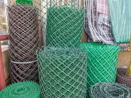 A rolled plastic (polymer) mesh. They are used in landscaping and landscaping as a decorative fence, create pergolas and arches to support plants, fencing sites, sites. Sale on the street. 写真素材