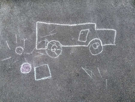 Children's drawing with chalk on the pavement. The child painted a white chalk car and the sun on the sidewalk. Concept: childhood, creativity, walks.