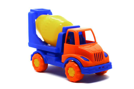 Children's plastic multi-colored toy concrete mixer on a white background. Toy vehicles, outdoor games for children.