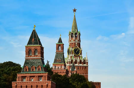 Spasskaya Tower of Moscow Kremlin against background of blue sky. Famous chimes are the main clock of Russia. Sights of Russia, a historical building, symbol of the country.