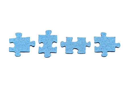 Row of four disconnected blue jigsaw puzzle pieces isolated on white background. Board home games and puzzles. Symbol of quarantine soothing activity. Concept of disunity, inconsistency.