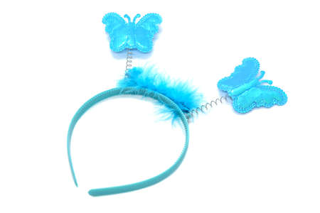 Bright blue children's headband for girl with butterflies on springs and decorated with feathers isolated on white background. Element of children's carnival costume, halloween outfit. Fairy costume