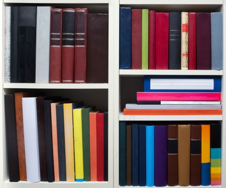 Books on a white shelf Stock Photo - 23879609