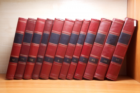 Stack of Old books on wooden background photo