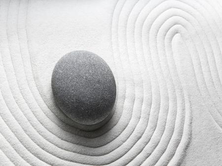relaxation zen garden, zen stone with raked sand  photo