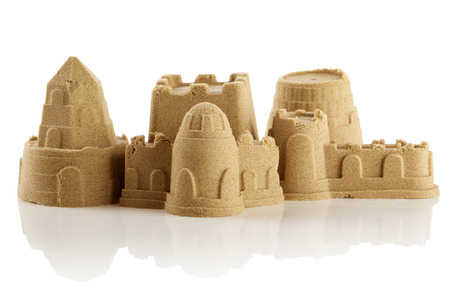 sand toys: Sandcastle at the beach isolated over white  Stock Photo