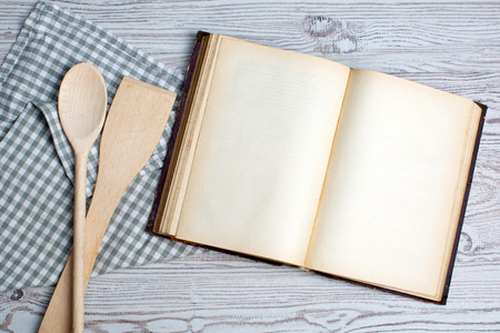 Cooking concept  Ingredients and kitchen tools with the old blank recipe book