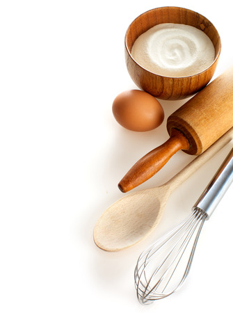 Ingredients and kitchen tools on white background   photo