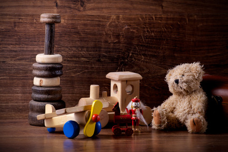 collection of old wood children toys with teddy bear