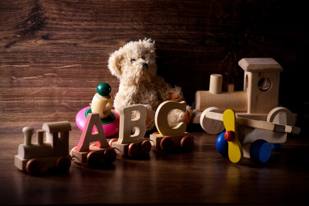 collection of old wood children toys with teddy bear photo
