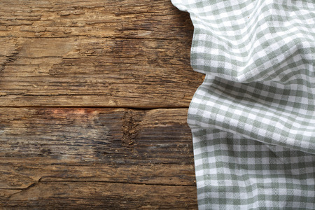 folded tablecloth on wooden table photo