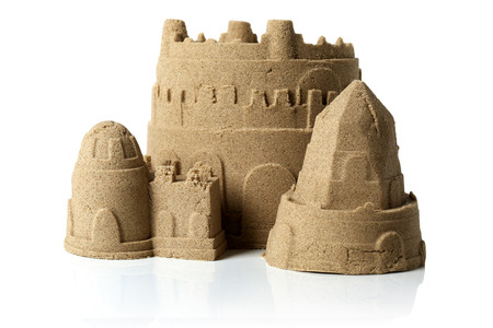 Sandcastle at the beach isolated over white