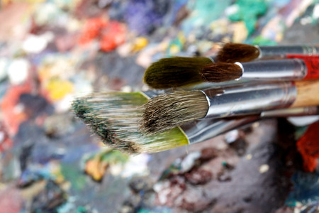 pallette: Brushes and colorful almost abstract pallet