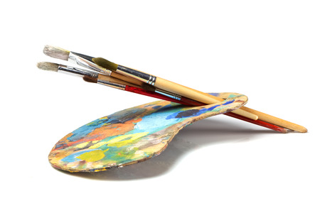 Art palette with paint and a brush on white background 免版税图像 - 31504397