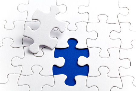 jigsaw puzzle pieces: Plain white jigsaw puzzle, on Blue background, autism awerness symbol