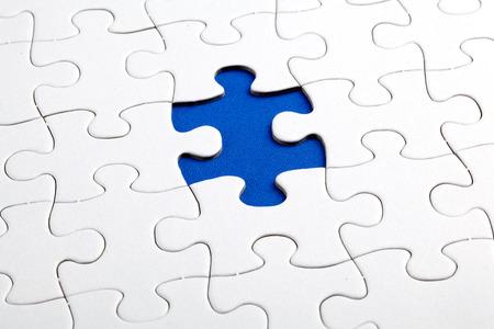 Plain white jigsaw puzzle, on Blue background photo