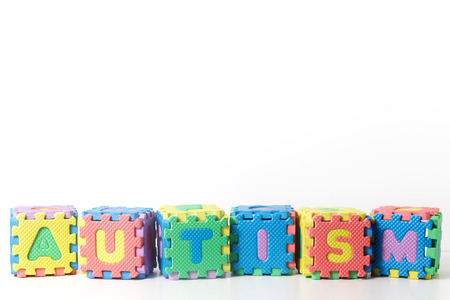 autism: Stacked blocks spelling autism on white background
