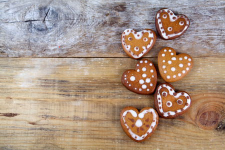 Gingerbread heart-shaped cookies on wooden background photo