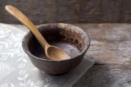Fasting, Lent. Cup and spoon on wooden background