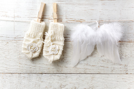 baby shoe: Decorations for newborn girl on wooden background