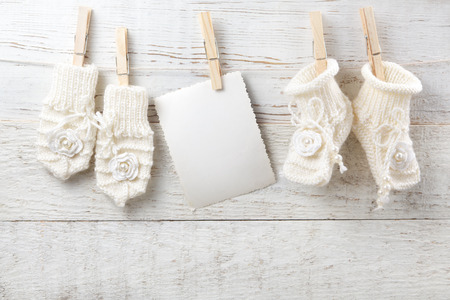 Decorations for newborn girl on wooden background