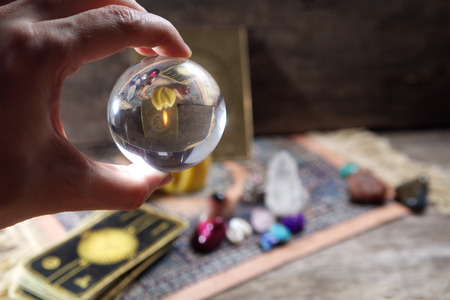 fortunetelling: Fortune-telling tools on wooden background