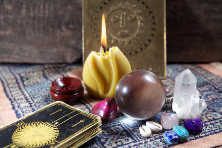 Fortune-telling tools on wooden background